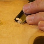 The careful removal of wood in just the right spot is critical during this tuning process.