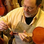 My spirit varnish is completely hand-made in my shop and hand brush applied. Each varnish coat is hand sanded between coats. When the final color is achieved, the instrument is hand-rubbed to a final gloss finished.