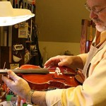 Careful consideration of sound post placement, bridge cutting and string height adjustments are critical in determining an instruments final sound production and playability.