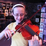 Abby Fairholm of Mechanicsburg, playing her recently purchased violin. One very happy camper.