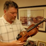 "Bill Rea, Jr. (Manteo, NC) is an East Carolina Bank V.P. and a very accomplished musician. He recently had major restoration done to his grandfather's violin. Bill is a member of the group ""The Crowd"" and can be contacted @ 252.202.5077 for bookings."