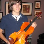 Logan Brown with his recently purchased handcrafted Hershey viola.