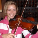 "Casey Tissue, Mech. PA. ""A Very Happy Camper"" with her new violin purchase from Hershey Violins. Casey has been playing violin for 6 years, is a junior @ Cumberland Valley H.S., plays 2nd violin and is on the track & field team. Thank you Casey for being a part of our ever growing team of talented musicians."
