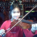 Deja Han (Mechanicsburg, PA) This energetic young lady is just begining to play the violin and attends the Upper Allen Elementary School. She is playing a 1/2 size instrument.