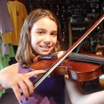 Emma Olofson (Mechanicsburg, PA). Emma is about to take lessons and enjoy her recently purchased 1/2 sized violin. She was quite excited to begin playing her new violin. Emma attends Hampden Elementary School.