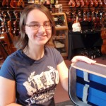 Erin Eckerd (Mechanicsburg, PA) This 10th grader with the Cumberland Valley High School is admiring her recently purchased deluxe violin case. Erin is 1st. violin in the CVHS Orchestra.