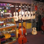 Santa Cruz guitars are displayed and ready for sale.