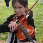 This talented young fiddler stopped by our booth to try our instruments at the Gettysburg Bluegrass Festival.