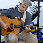 Kevin Neidig (a featured link on my site), a professional guitarist and singer/songwriter, performs at our booth during the Gettysburg Bluegrass Festival.