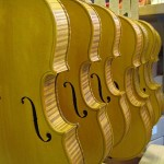Violins with their first sealer coats applied. Color coats will now begin.
