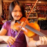This very happy young lady, Jasmine Sariano of Etters, PA stopped by my shop today to pick up her recently rehaired bow  and her parents suggested she look at some new violins. After looking and playing a few in her price range, she settled on this one. Very happy indeed. Jasmine attends the Redland High School and is in the orchestras first violin section, the octet and the quartet groups. One very talented violinist.