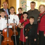 """The King's Strings"" (Mechanicsburg, PA) Shown here with Gov. Ed Rendell of PA. Keeping their instruments up to playing order is a full time job for dad John and Hershey Violins. For bookings contact: kingzoo@comcast.net or 717-697-3424. Web: thekingsstrings.com/"