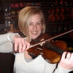 Lashae Willits (Enola, PA) Violinist and Orch. Director for the Mechanicsburg, PA High School trying out her recently services instrument. Ms. Lashae was very pleased with the results of this repair.