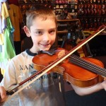 "Marqus Toevs (Mechanicsburg, PA). Marqus was excited to begin playing his newly purchased 12"" viola. He attends the Monroe Elementary School and is in the 4th grade."