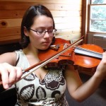 Nicole Leon (New York, NY), stopped in for two bow rehairs while attending the WBIMF. Nicole is a student of Itzhak Perlman in NY. She attends Julliard and is one very talented young lady. Shown here playing a Hershey Violin that she very much enjoyed.