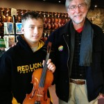 Two musicians meet at Hershey Violins. Carl Iba violinist with the Harrisburg Symphony and teacher meets Nikolai Mortorff (14), student from Red Lion Ares Sr. High School yesterday at Hershey Violins. Carl came in to pick up his bow rehair while the Mortorff family was busy choosing a fine violin for Nikolai to buy for his next big move to a better violin. This was a great moment for Nikolai when he made his final violin choice and to meet a professional musician Carl Iba. A great day for all.