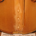 On this repair cleets are shown over a center crack on a violin top.