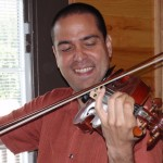 Romulo Benavides (Flushing, NY) Shown here enjoying playing my #55 violin while his instrument was in my shop for a much needed face lift. Retouching, French polishing and tonal adjustments. Romulo was a faculty member and performer during the 2010 WBIMF.
