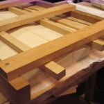 "This jig is used to tightly hold the ""book matched"" joined wood. Hide glue is used here."