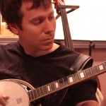 Jonathan Frazier picks out a tune on the banjo