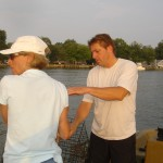 Mark and sister Deb tossing crab traps on Back River, MD.
