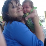 Mom Holly and newborn Rowan. She loves the wind in her face!