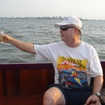 "Manteo's one and only Dockmaster Carl, toasting the ""Lazy Lucy""."