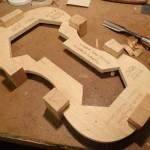 The corner and end blocks are glued in place and the pattern has been traced unto them.