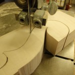 After the neck block has been squared up, the scroll cutting begins.