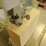 A large band saw is used to cut the basswood blocks to their proper dimensions.
