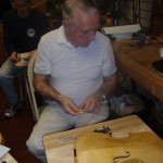 Harry Mayden is reviewing his bridge cutting in advance of his instruments completion.