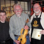 Jim Wilson, center with his finished violin. Gregg and Scott presenting tone and craftsmanship certificate.