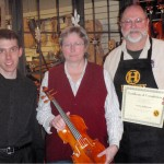 Sandra Schlessman, center with her finished violin. Gregg and Scott presenting tone and craftsmanship certificate.