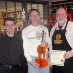 Steve Murphy, center with his finished violin. Gregg and Scott presenting tone and craftsmanship certificate.