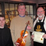 Thomas Loughry, center with his finished violin. Gregg and Scott presenting tone and craftsmanship certificate.
