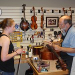 Casey Mason and Scott discussing adjustments to her cellos.