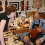 Elizabeth Yanuschkevich and Scott consult on her violin.