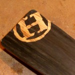 "The ""H"" inlay prior to drilling and varnishing."