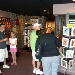 More visitors enjoying Deb's print collages and cards. This was a very rewarding day for all customers and store owners. Don't miss out on our next town event. Come out and enjoy our next Mechanicsburg Art & Wine Walk in September2011