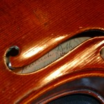 The ff hole detail is well defined and the original label and branding are still very much intact. This instrument has a stamp #528 on the inside. and is a model 1714 Strad.
